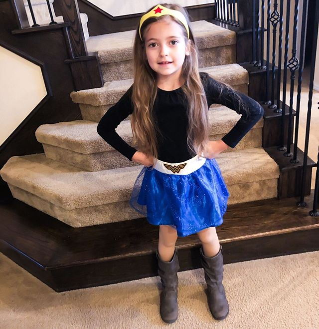"""She's been trying to get me to let her wear this skirt and headband to school for DAYS. I was like, """"No, that's not an outfit, that's a costume."""" But she's as stubborn and unrelenting as I am. (Well, more apparently. Lol!) She wore me down and finally last night, in a moment of weakness I threw my hands up and said, """"Fine! Wear it!"""" Then this morning I saw her in it and for the life of me, I can not figure out why I was telling her no! 💫💪🏼😍 #beautiful #parenting #family #mom #motherhoodrising #love #momlife #momsofinstagram #kids #happy #momswithcameras #thatmomlife #mydaughter #princess #daughter #wonderwoman #ohheymamas #stronggirls #girl #inspiration #motivation #motherhoodjourney"""