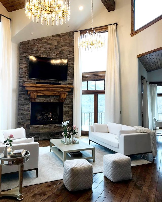 Such a fun project we worked on earlier this year! Our client didn't love the rustic, heavy feel of the home, and especially in the front room wanted an upscale, elegant hotel lobby feel. We lightened up the walls, switched the ceiling fans out for these gorgeous chandeliers, changed and rearranged the furniture, and fancied the windows up with floor to ceiling drapery. Swipe for a before photo!