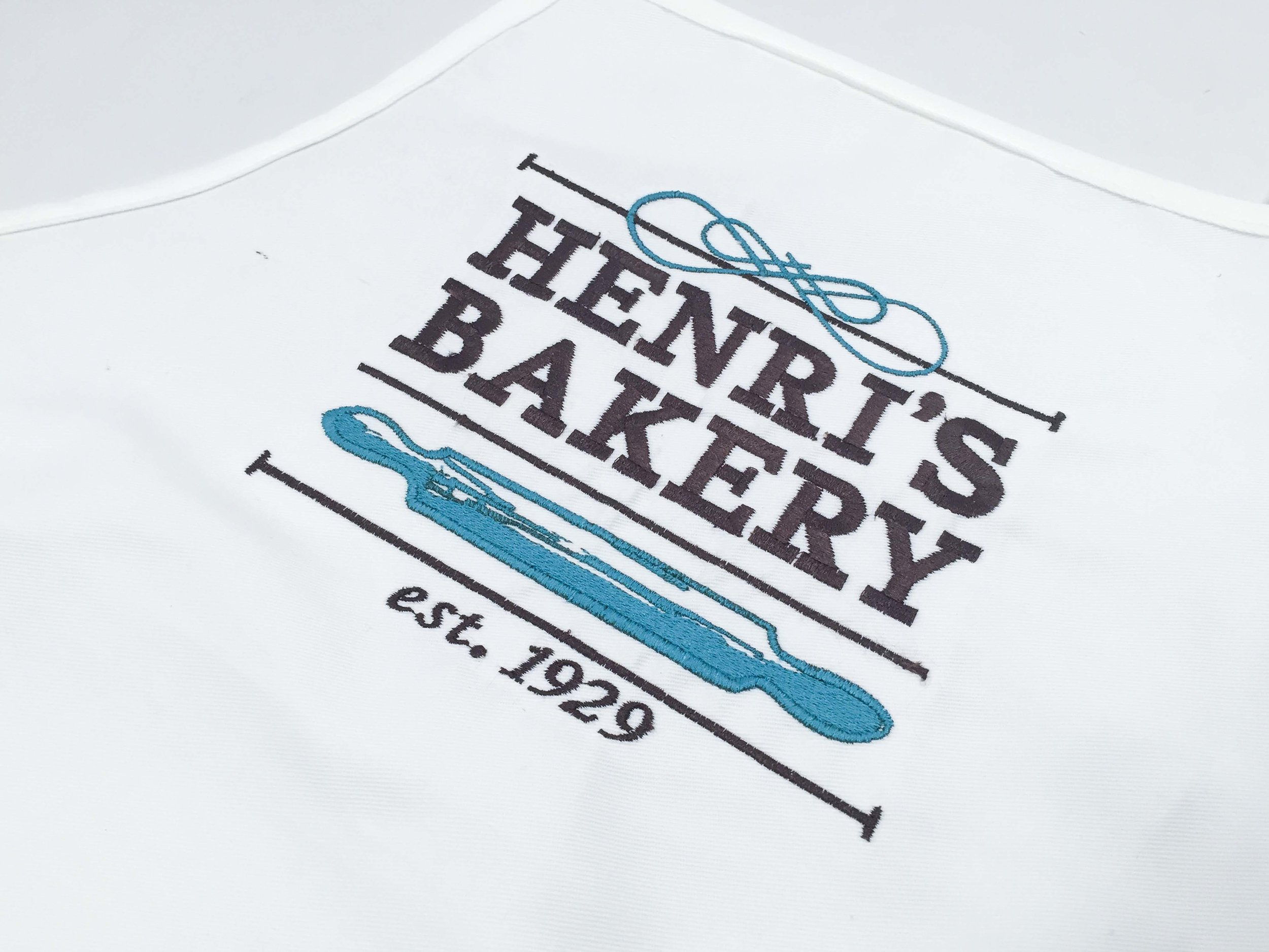 HENRI'S BAKERY - Henri's Bakery is a landmark to historic Buckhead in Atlanta, Georgia. I created this redesign during Studio 2 in Spring 2015 to give Henri's a modern yet traditional new identity. The system includes a modular combination mark featuring three colors and three baking utensils. That was then applied to stationery, packaging, promotional items, and their website.