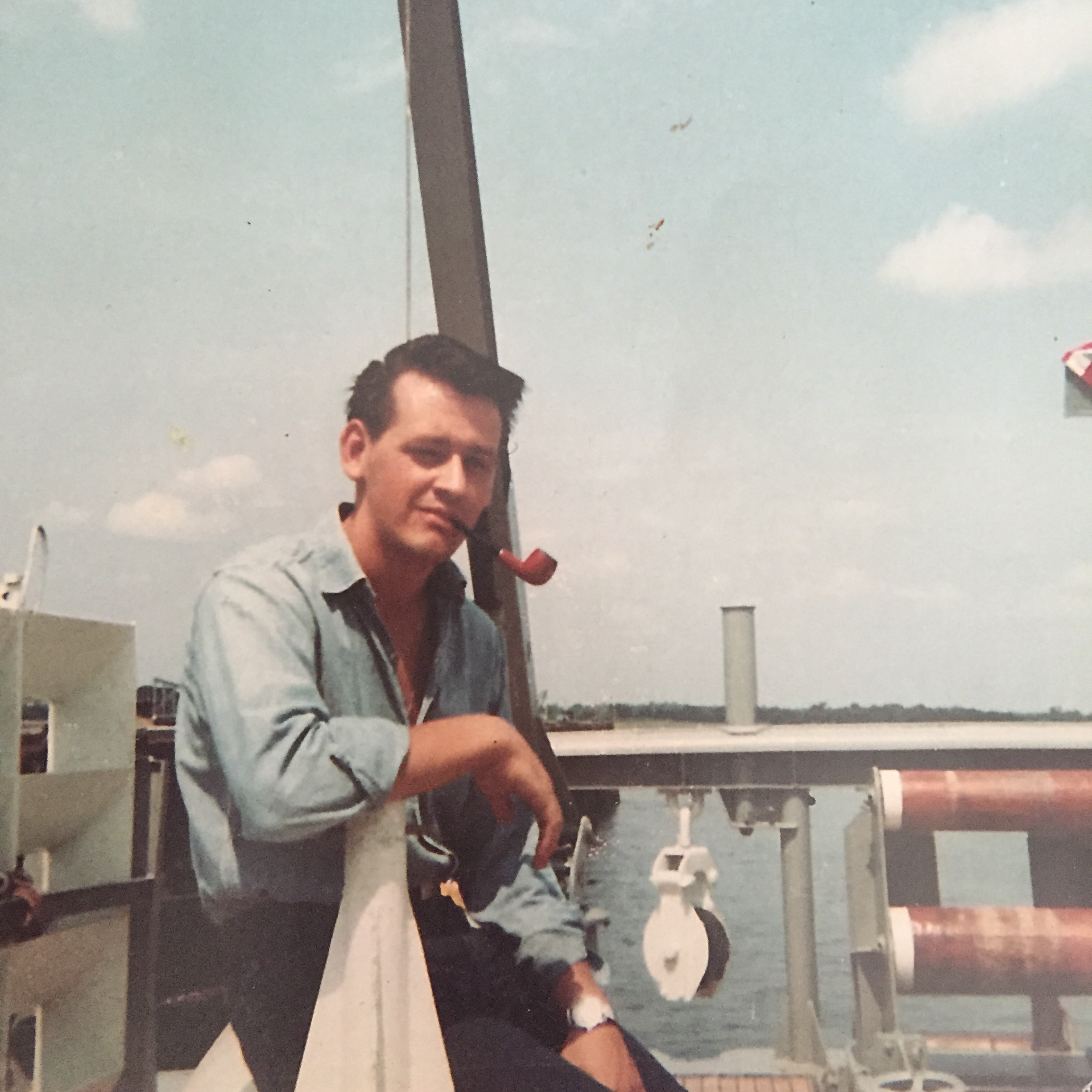 This guy...yeah that's my Dad aboard the mine sweeper on which he served during his four years in the Navy.