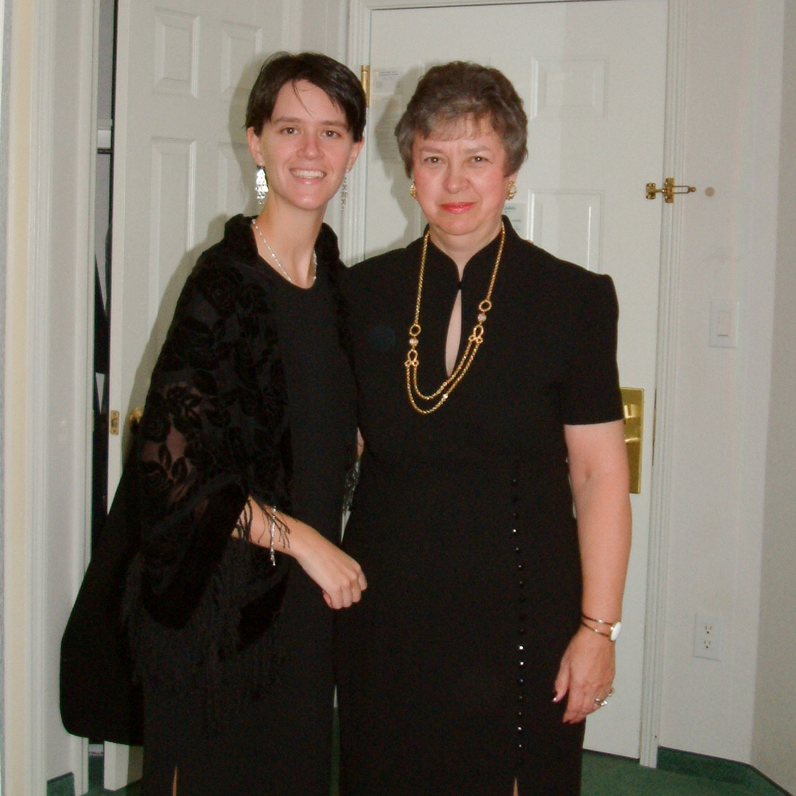 This is one of about five pictures I could find of me with my Mom...yes I'm wearing a dress and fishing lure earrings.