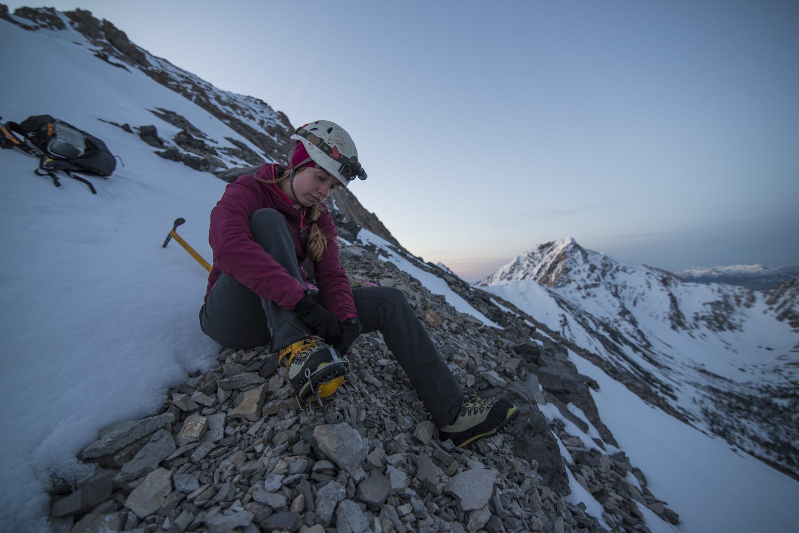 Megan putting her crampons on before the first snow field on Borah Peak.