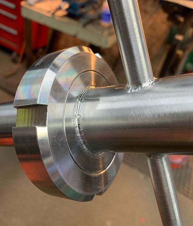"""Another large racking arm for @bissellbrothers  1.5"""" process pipe. The bent section is first welded to a tc flange with a 4"""" shoulder, the tapered collar slides over that weld seam and then is welded top and bottom. Threaded lock ring is then installed and the handles welded in. Longer handle indicates the """"up"""" position of the bend. Fully purged throughout.  #welding #processpiping #sanitarywelding #brewery #craftbrewing"""