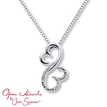 Open Hearts Family 1/20 ct tw Diamonds Sterling Silver Necklace    This pretty diamond necklace is fashioned with 1/20 carat total weight of round diamonds in a setting of sterling silver.