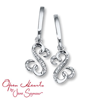 Open Heart Earrings 1/20 ct tw Diamonds Sterling Silver    The iconic Open Hearts design sparkles with round diamonds as it dangles from a sterling silver setting in each of these stylish earrings for her. The earrings, from the Open Hearts by Jane Seymour® collection, have a total diamond weight of 1/20 carat and are secured with friction backs. Diamond Total Carat Weight may range from .04 - .06 carats.