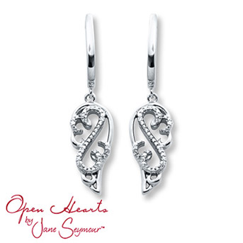 Open Hearts Earrings 1/20 ct tw Diamonds Sterling Silver    Sterling silver angel wings frame the diamond-adorned Open Hearts design in these charming dangle earrings for her. The diamond earrings, from the Open Hearts by Jane Seymour® collection, have a total weight of 1/20 carat and are secured with friction backs. Diamond Total Carat Weight may range from .04 - .06 carats.