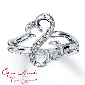 Open Hearts Ring 1/20 ct tw Diamonds Sterling Silver    From the Open Hearts by Jane Seymour® collection. The iconic Open Hearts design is decorated with brilliant round diamonds set in sterling silver in this irresistible diamond ring for her. Total diamond weight is 1/20 carat. Diamond Total Carat Weight may range from .04 - .06 carats.