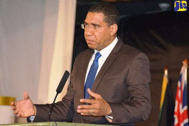 Prime Minister Andrew Holness address utility chiefs at a conference in October 2016