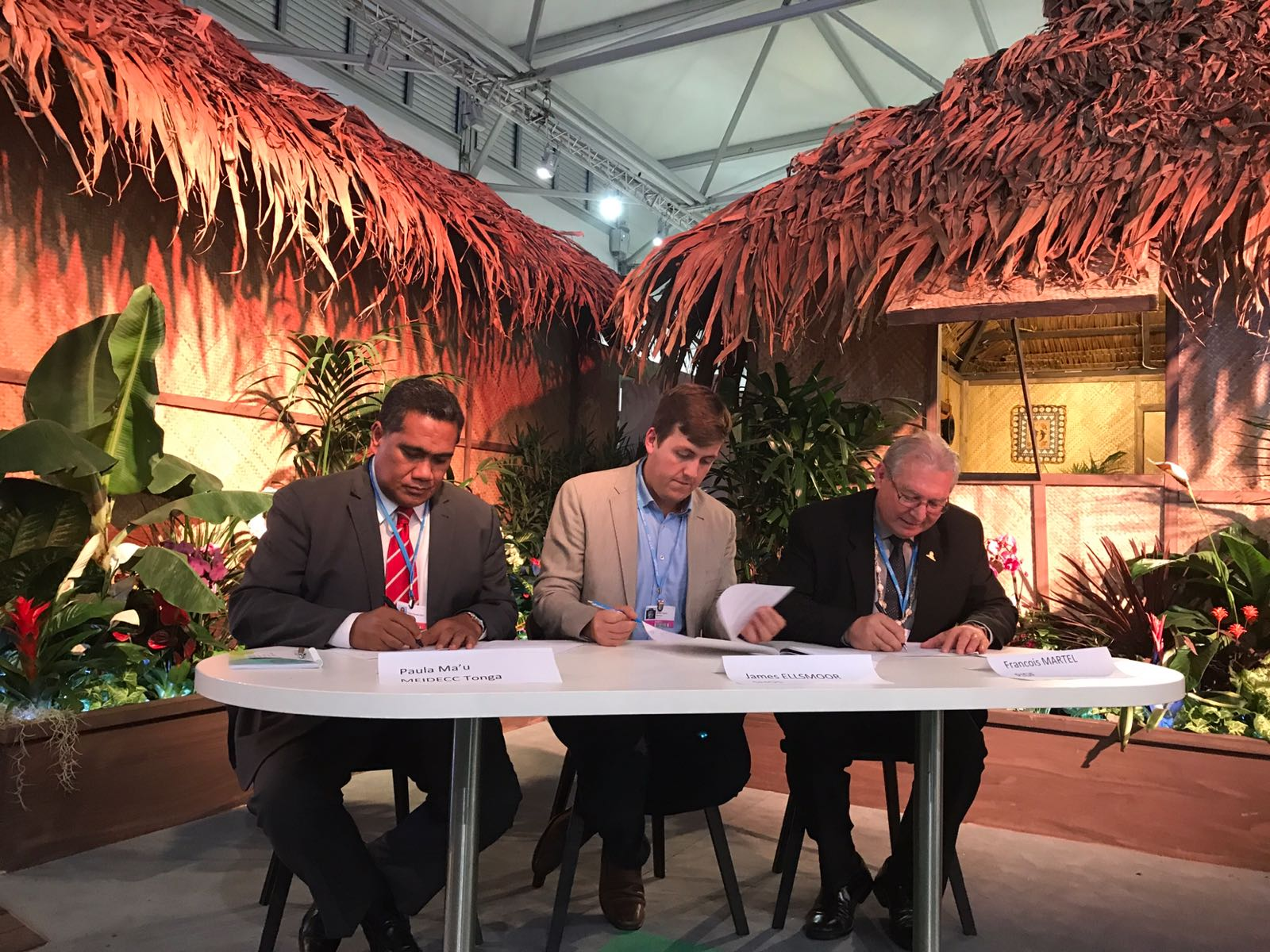 Delegates sign the agreement for solar on St George's Palace. From left to right: Tonga's Paula Mau'u, SHOS's James Ellsmoor and PIDF's François Martel.