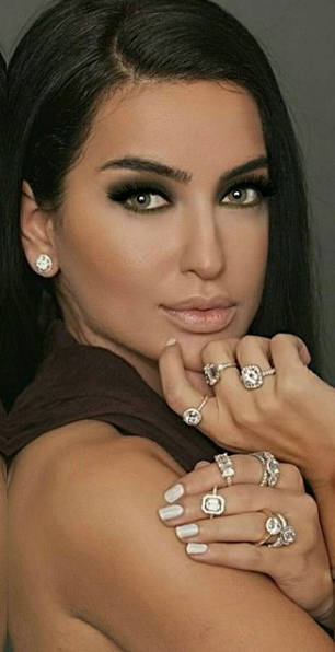 - Gina Amir wearing all one of a kind custom engagement rings designed by her and a set of her one of a kind diamond studs.