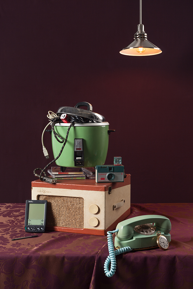 """Tech Vanitas"" still life photography presenting technology in the style of Dutch vanitas paintings."