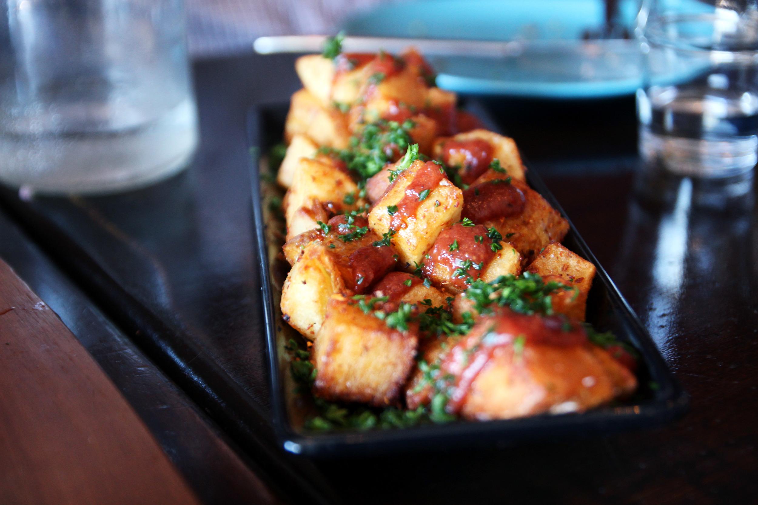 Batata harra cubed fried potatoes with house spice blend & tomato chutney