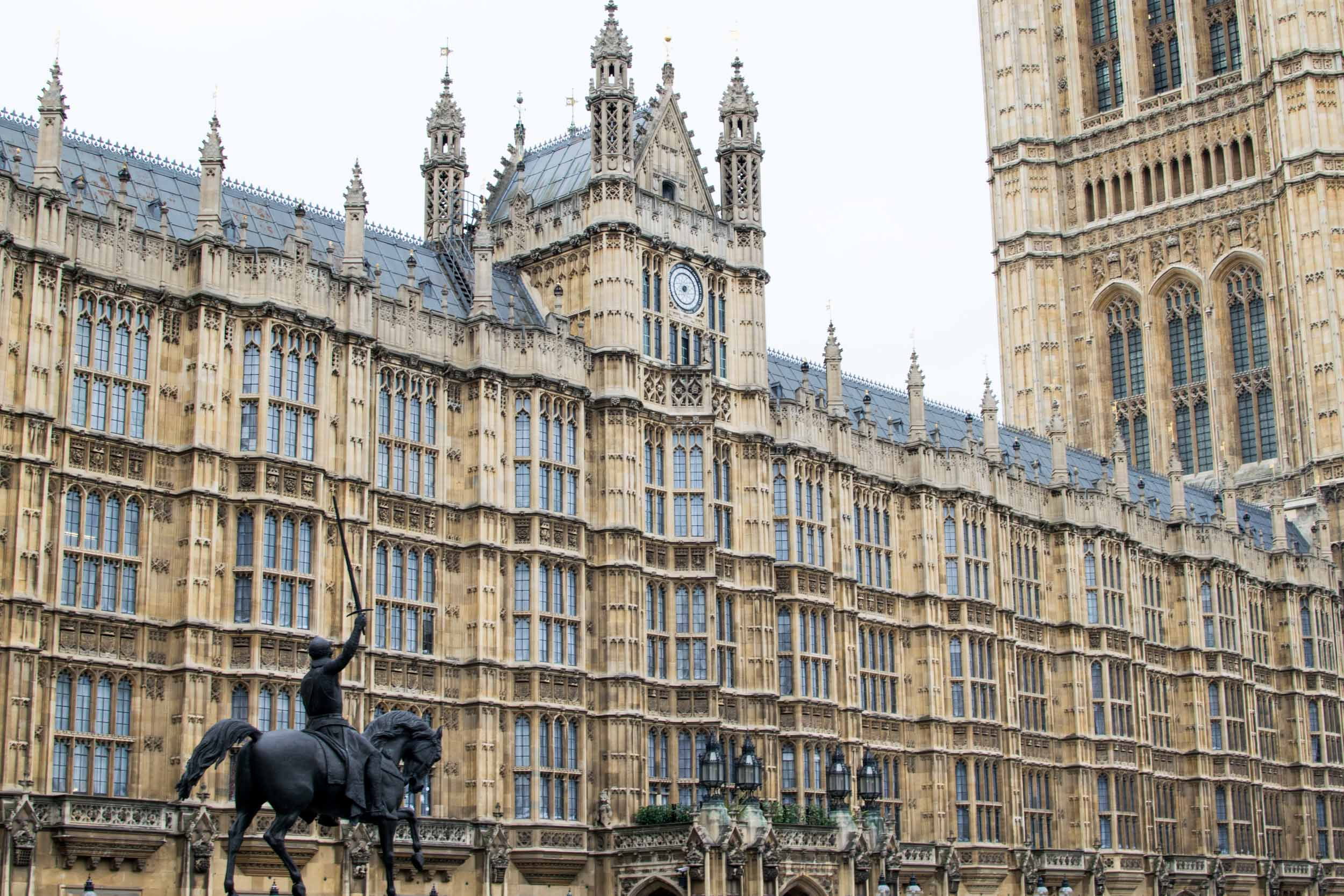 The House of Lords with horseman statue in London.