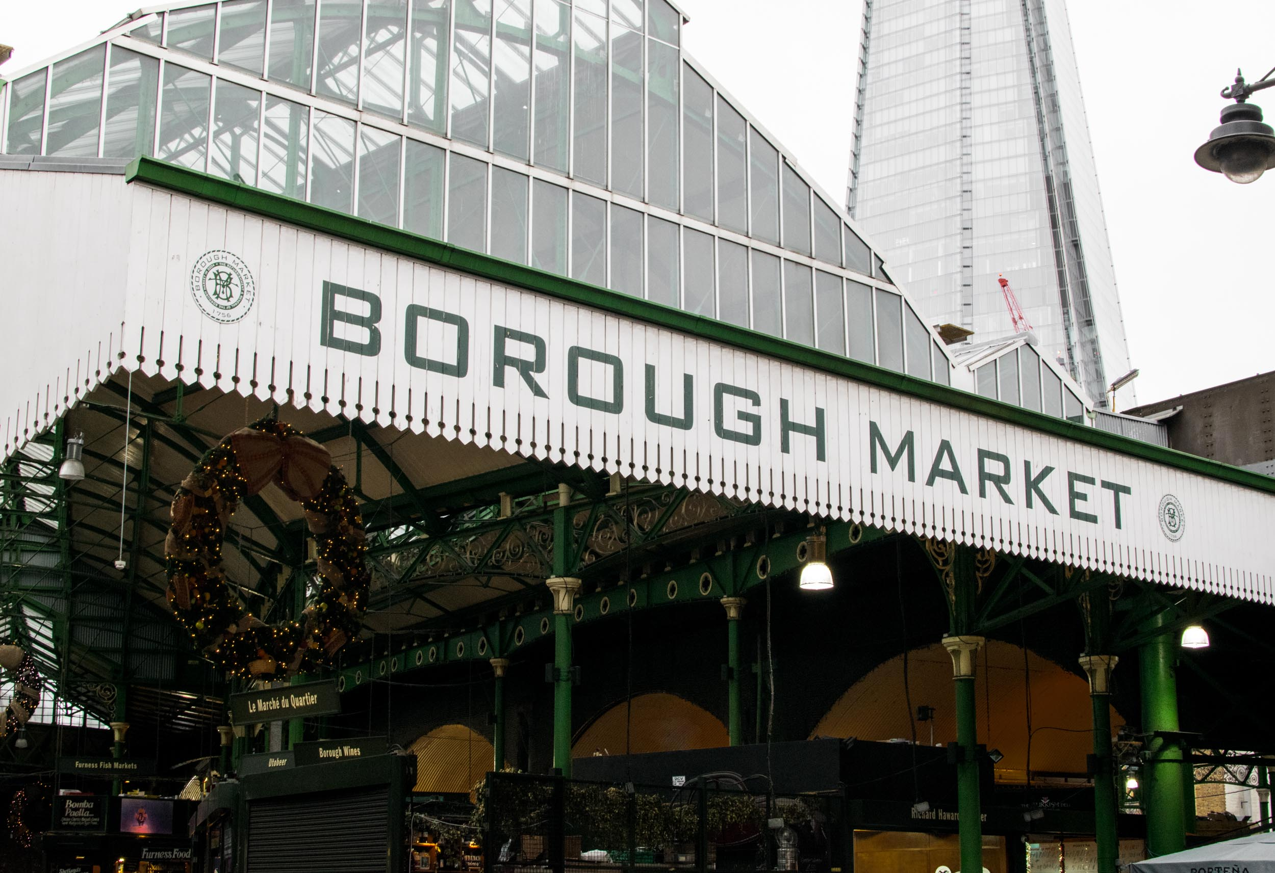 Borough Market, London's oldest foodie market with the Shard behind it.