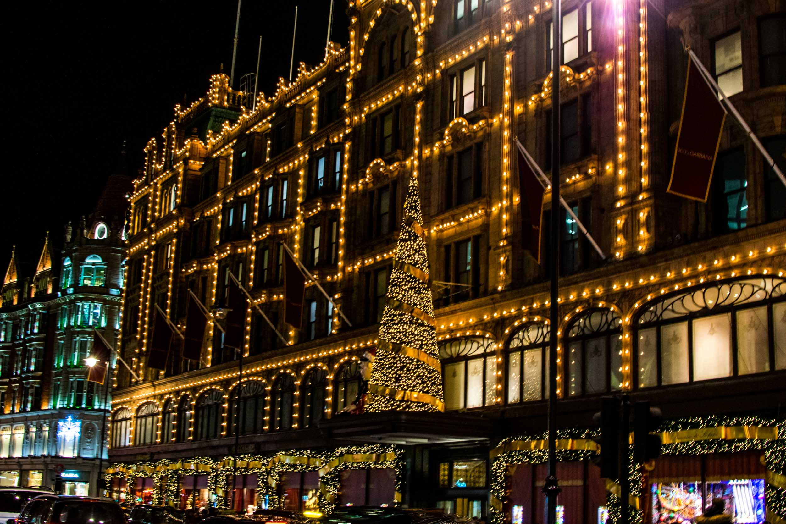 Christmas tree and decorations on the outside of Harrods department store, London.