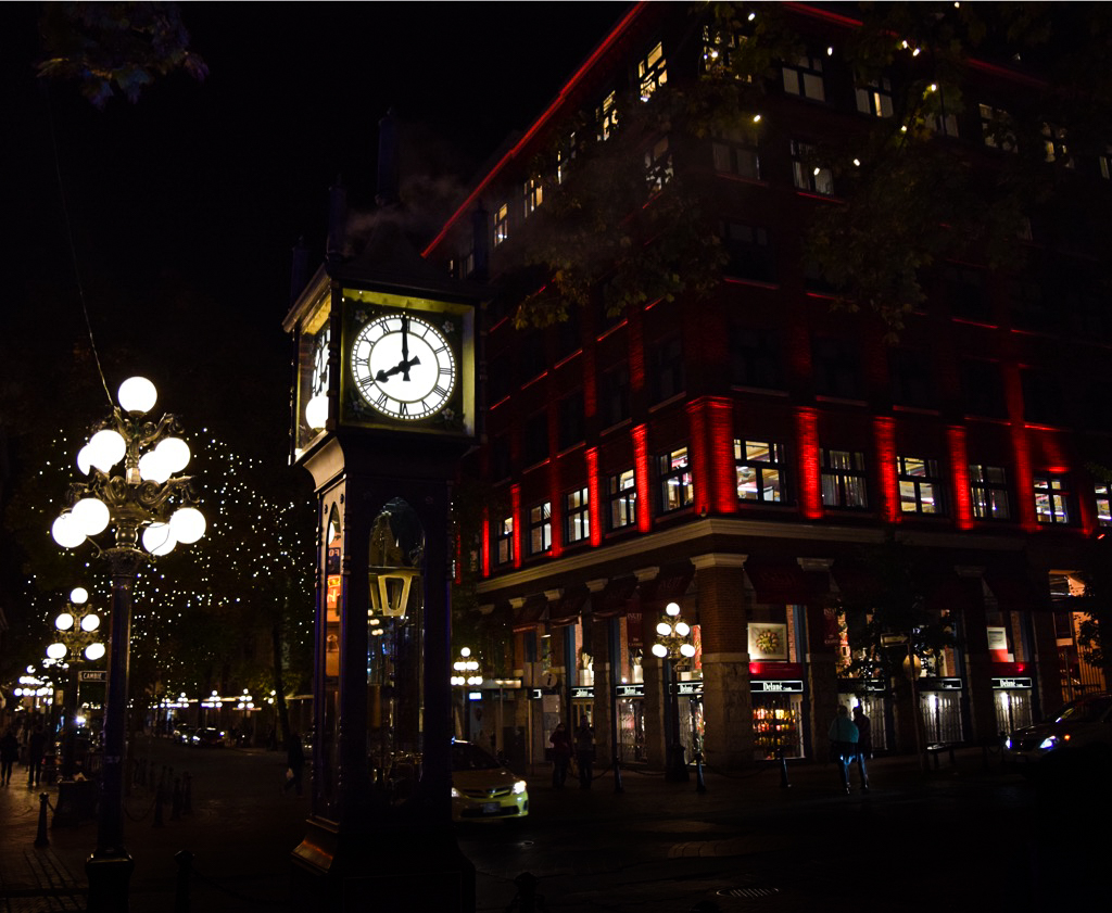 The Steam Clock in Gastown, Vancouver with street lights behind.