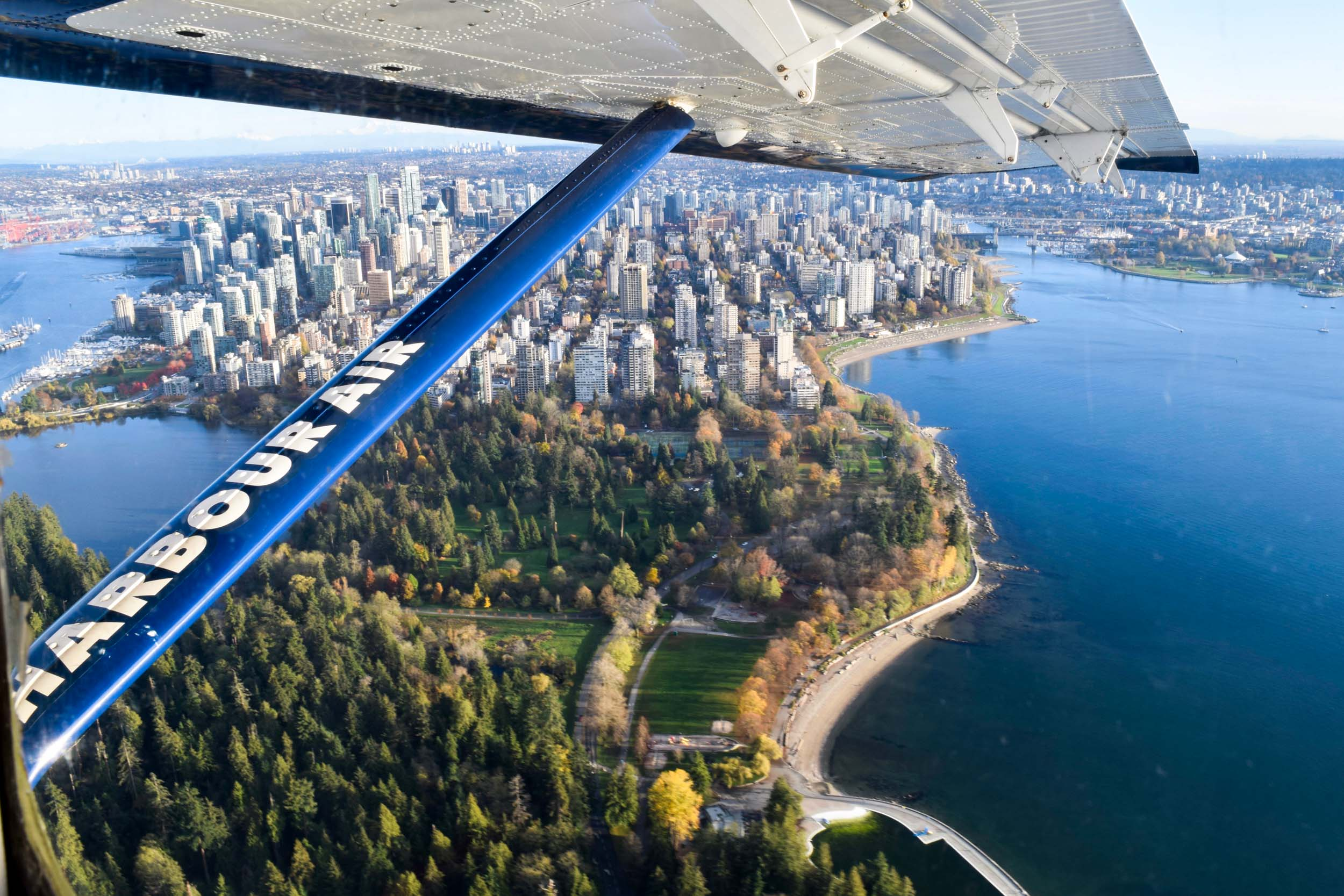 On board a Harbour Air seaplane, flying over Vancouver's Stanley Park and downtown.