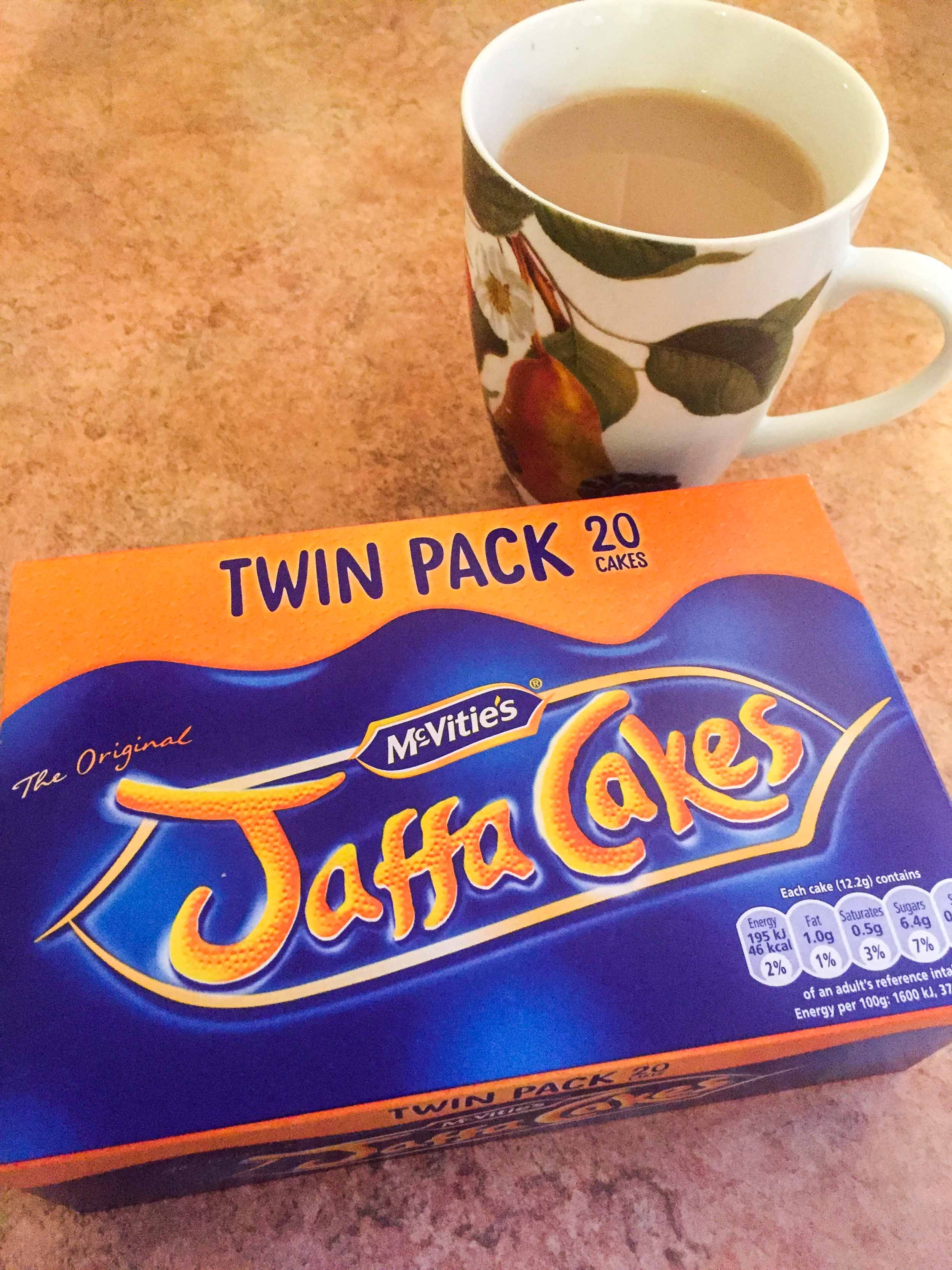 Jaffa Cakes biscuits and a cup of tea - British snacks.