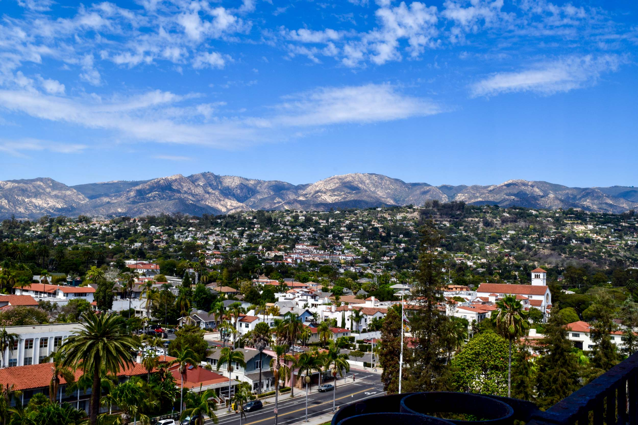Views over the red-bricked roofs in Santa Barbara with the mountains behind. California, USA.