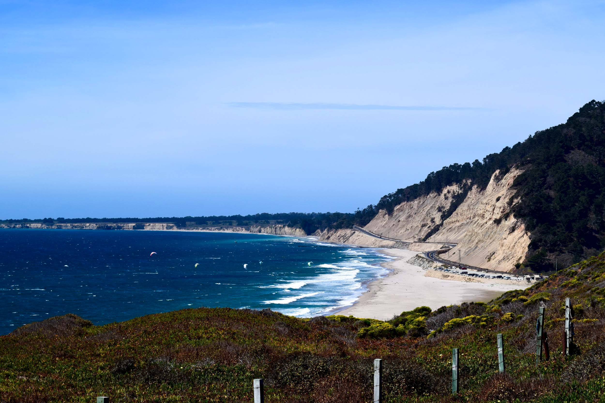 The Pacific Coast Highway, California, USA. A gorgeous coastal highway, with the beach and kite surfers just metres from the road.