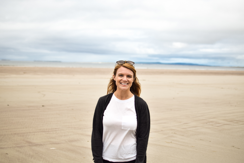 Woman stood on Kilcummin Beach, County Kerry. Part of the Dingle Peninsula in Ireland.