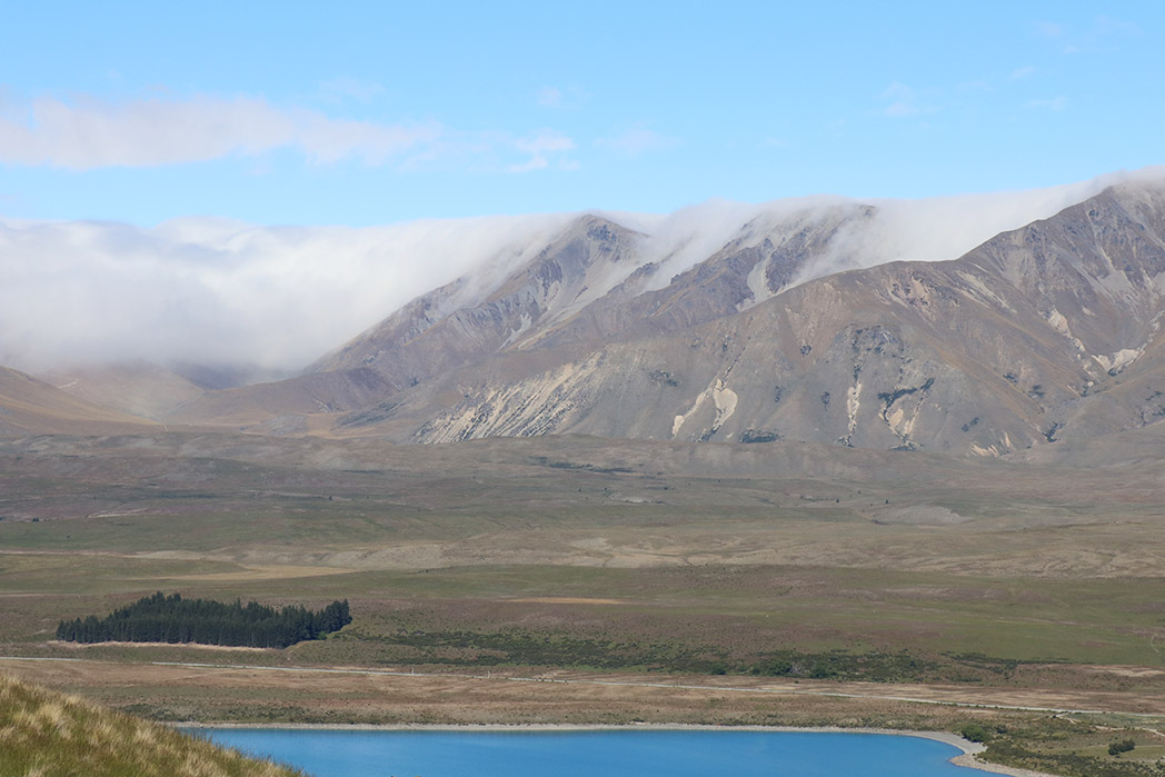 Clouds spilling over the Two Thumb range behind Lake Tekapo
