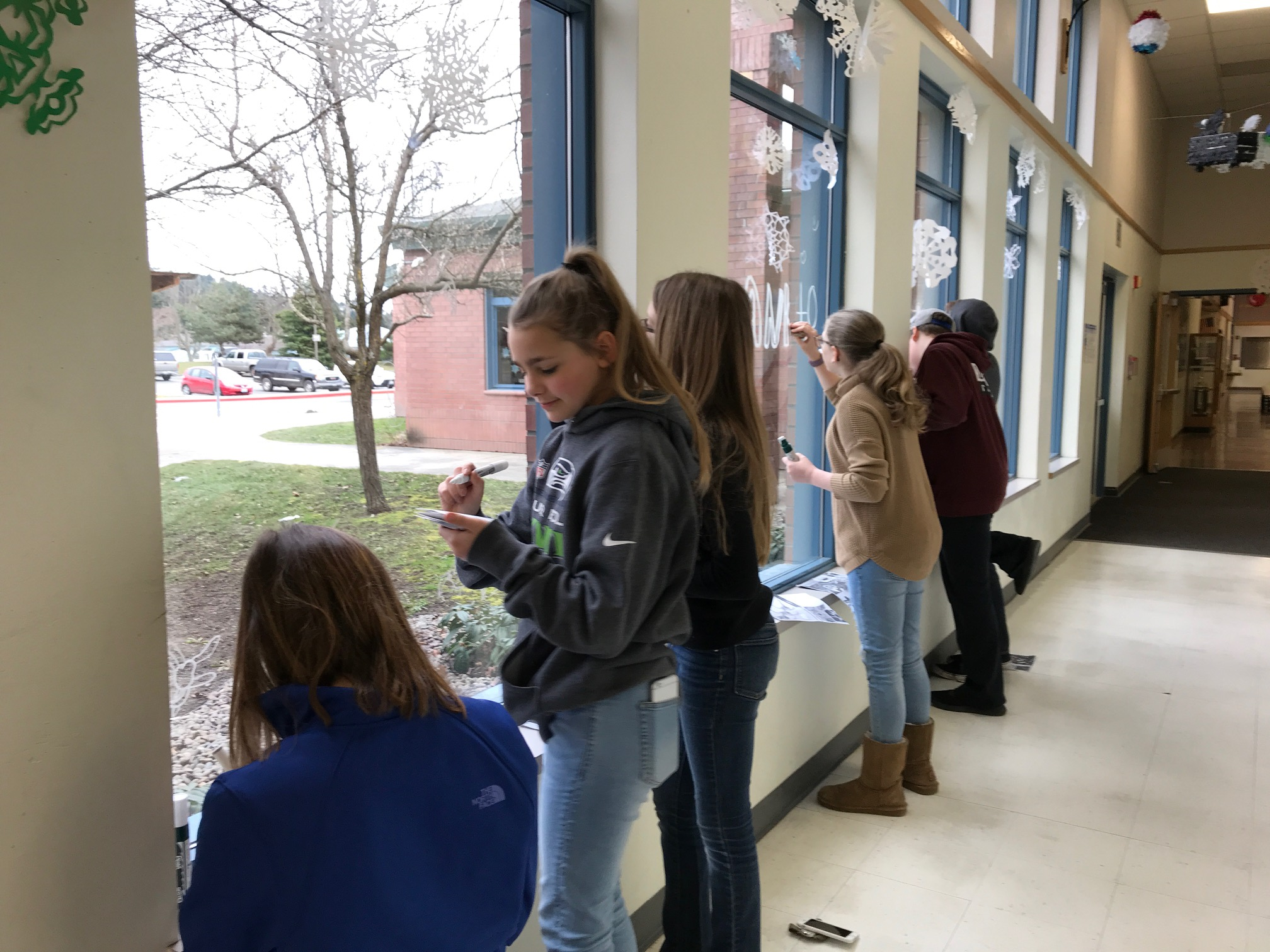 6th graders drawing plankton graffiti on school windows