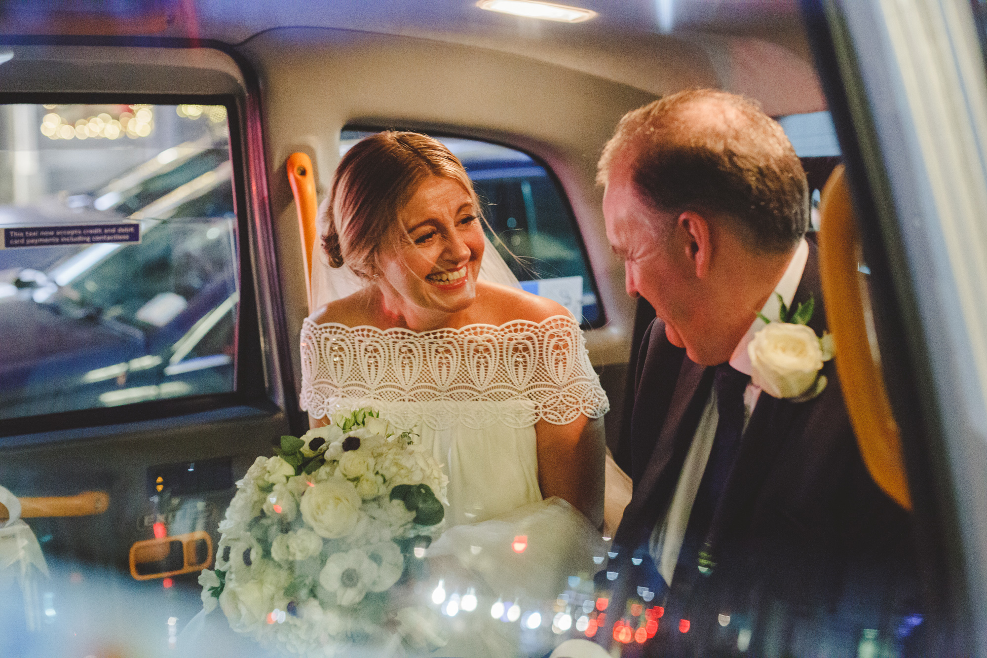 london wedding photographer, bride in wedding taxi with vintage dress