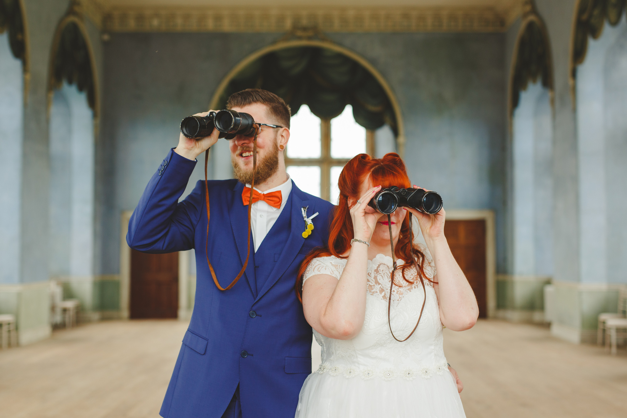 couple with binoculars, cute wedding photo, wes anderson style wedding photography in nottingham