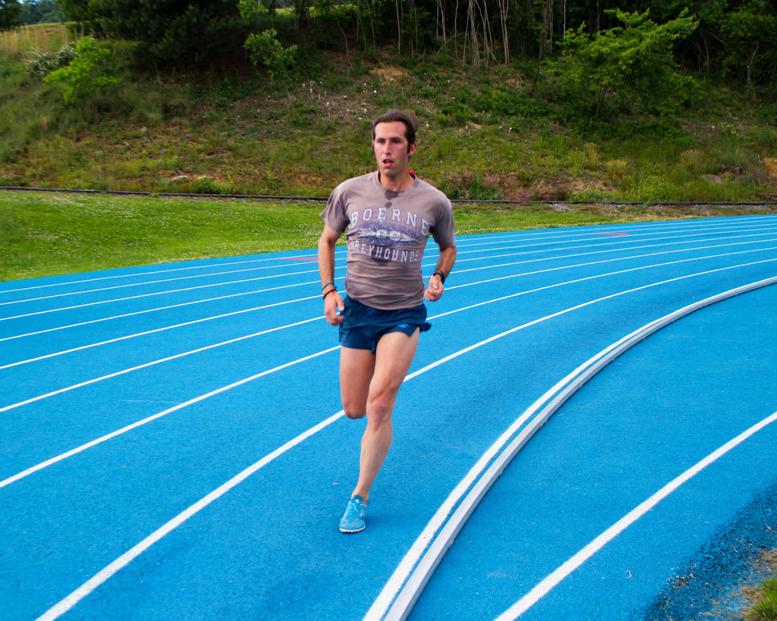 Chass Armstrong rounding the track in one of his recent marathon tune-up workouts.