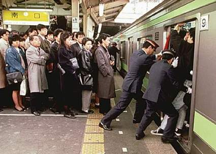 People being pushed into a crowded train in Tokyo