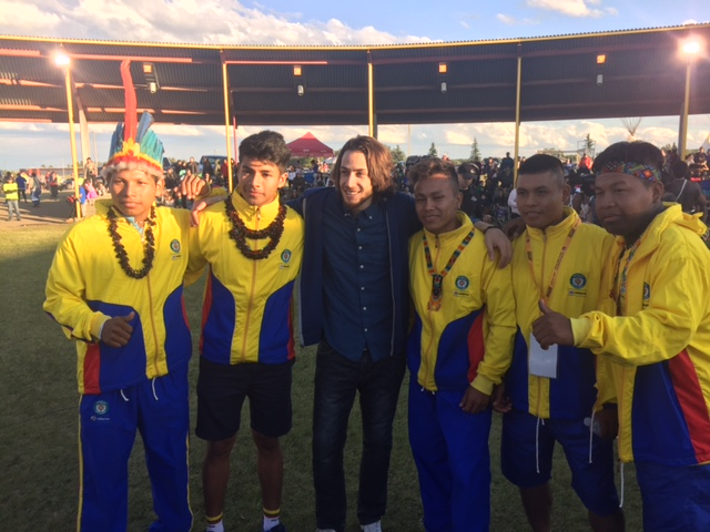 Bashar Dyab from Syria and Team Colombia celebrate the start of the WIN Games