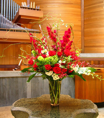 4. Red gladiolas and red roses in church