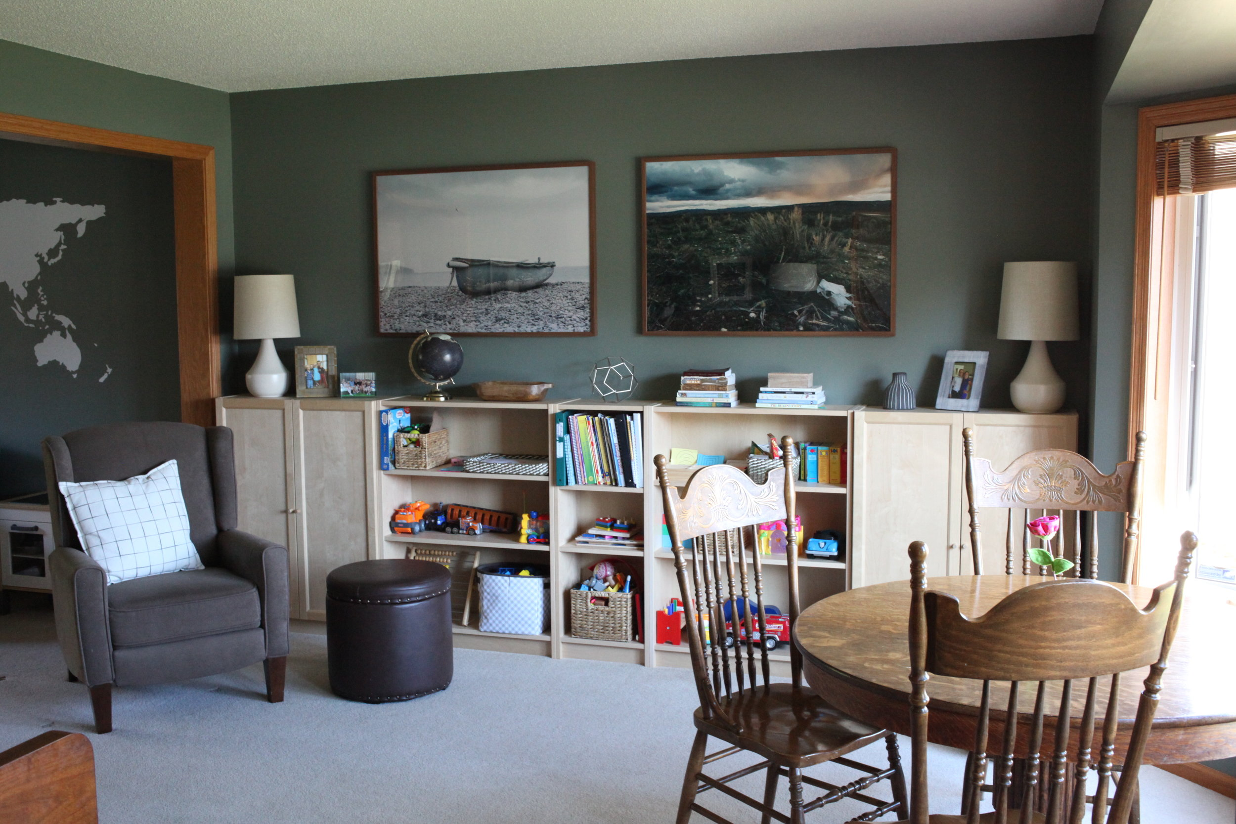 Home school room makeover with large photo art and round antique table. IKEA Billy bookcase