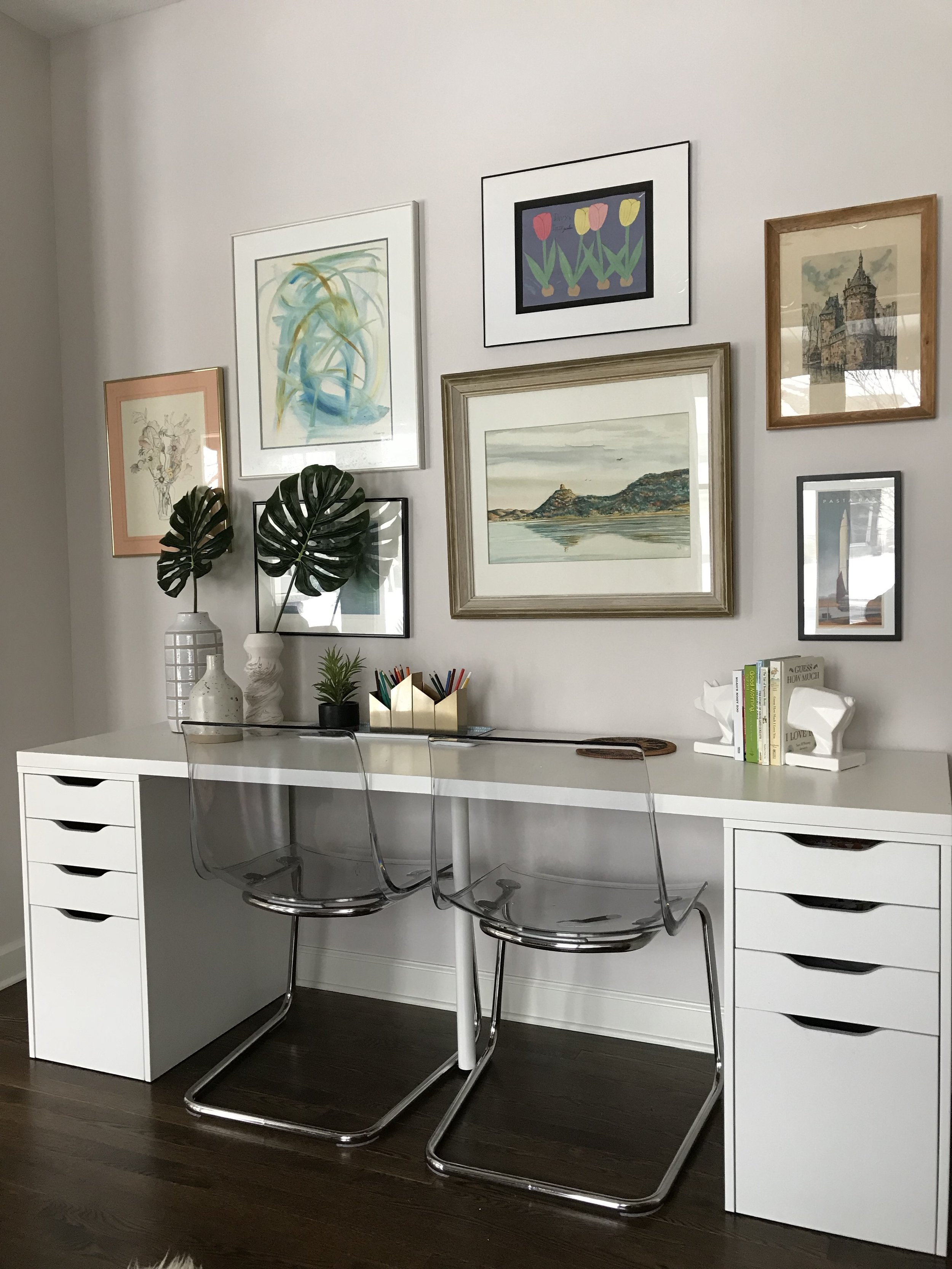 Office gallery wall with IKEA Linnmon white desk and acrylic chairs