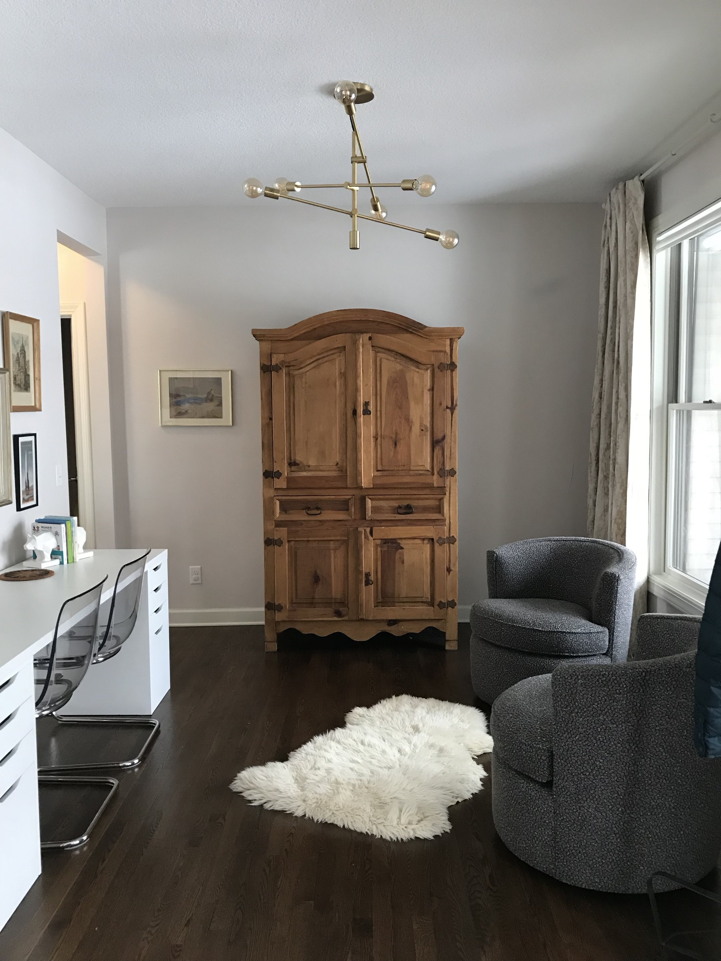 Pine bureau in a modern office with sheep skin rug.