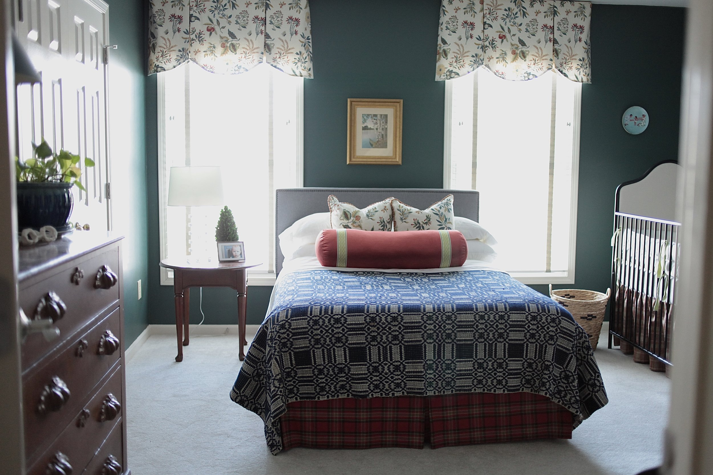 Traditional bedroom with antique throw. Goodwin Green paint