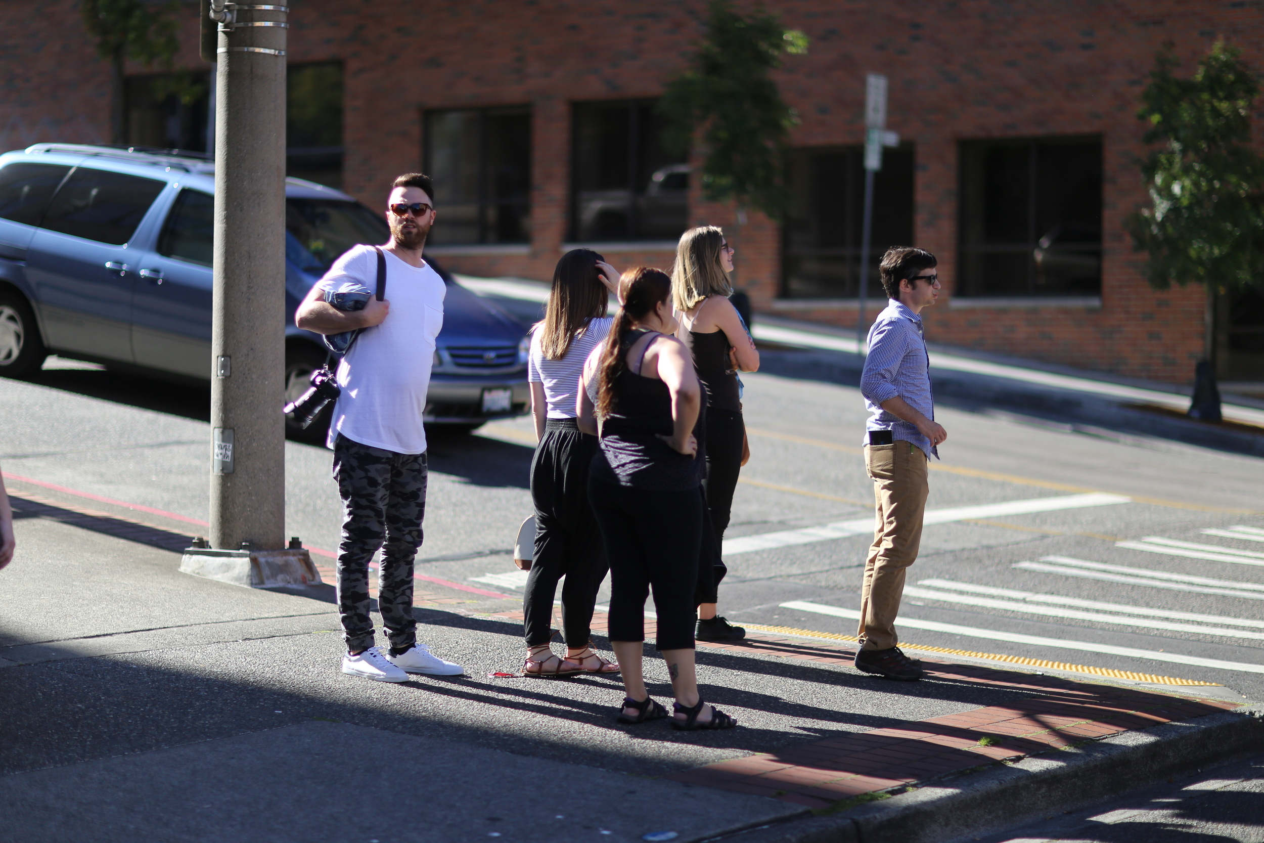 The tour group takes a long walk up Broadway in Tacoma