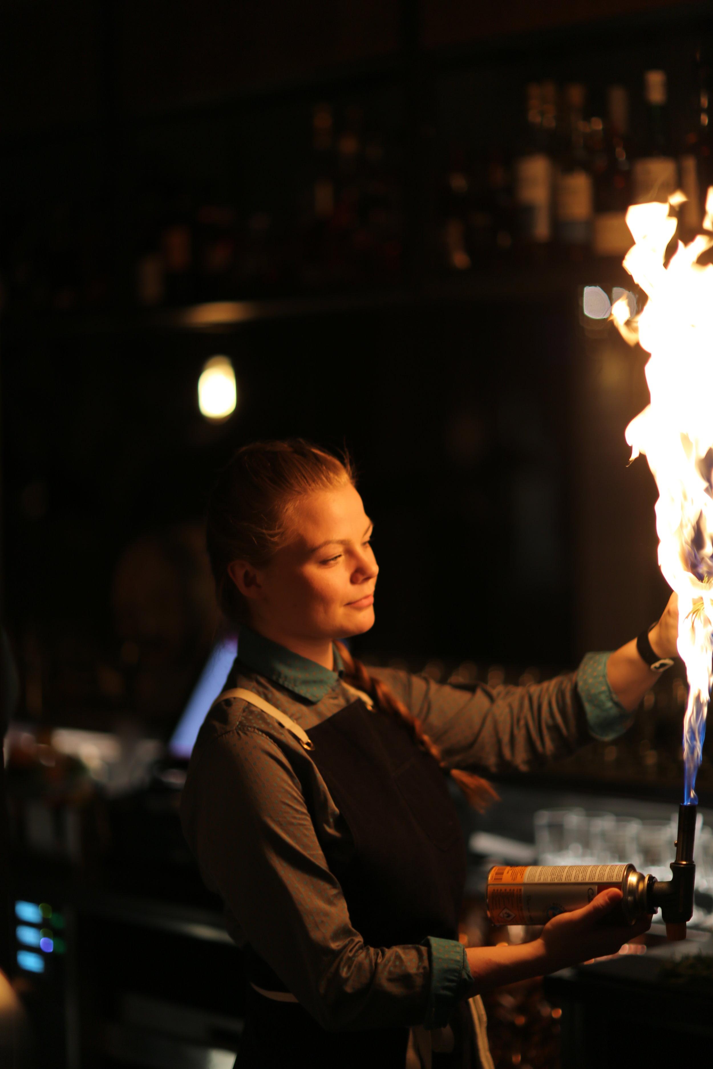 Þelma lights a fire