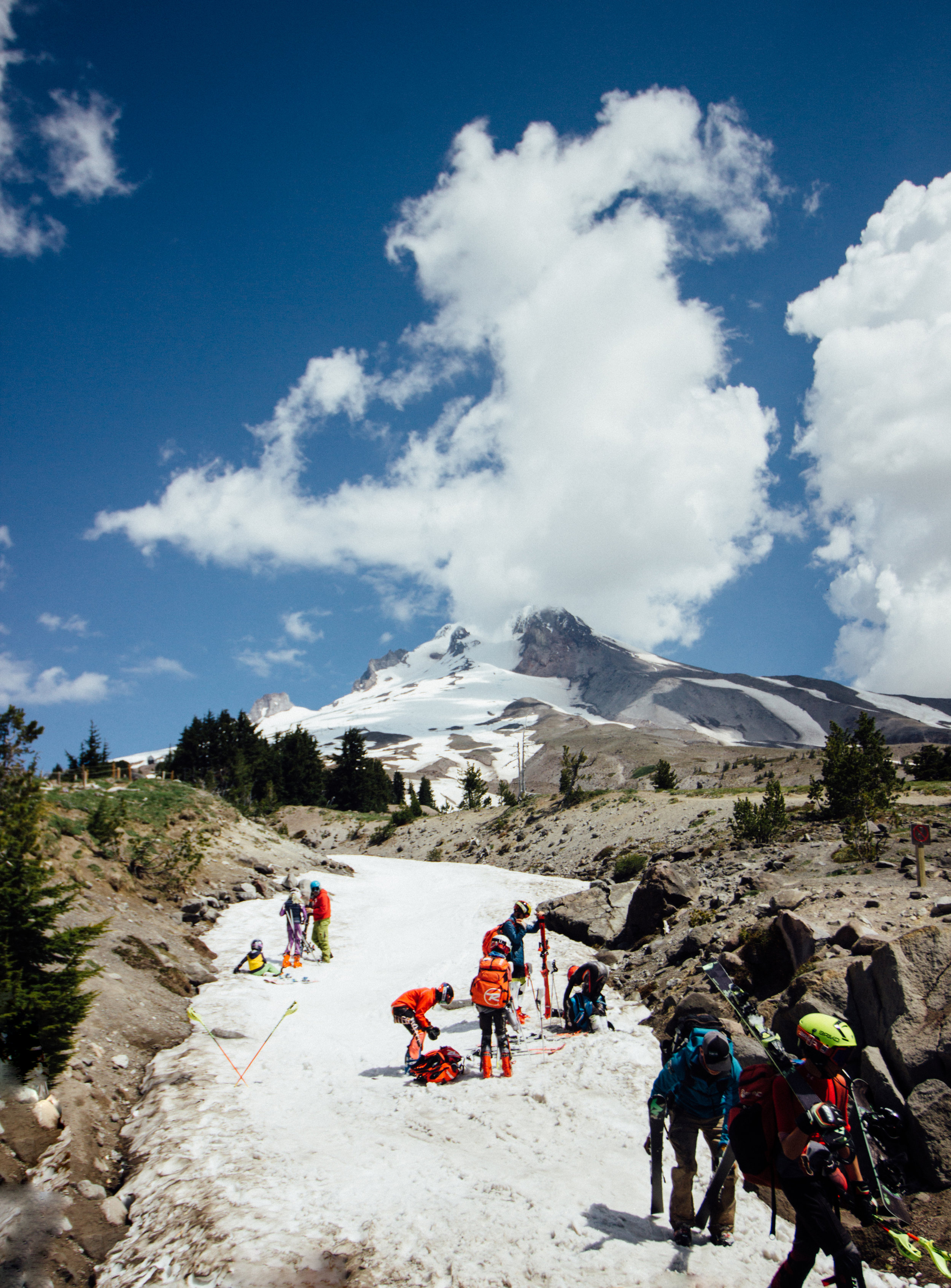 Snow boarders and skiers coming down from Mount Hood