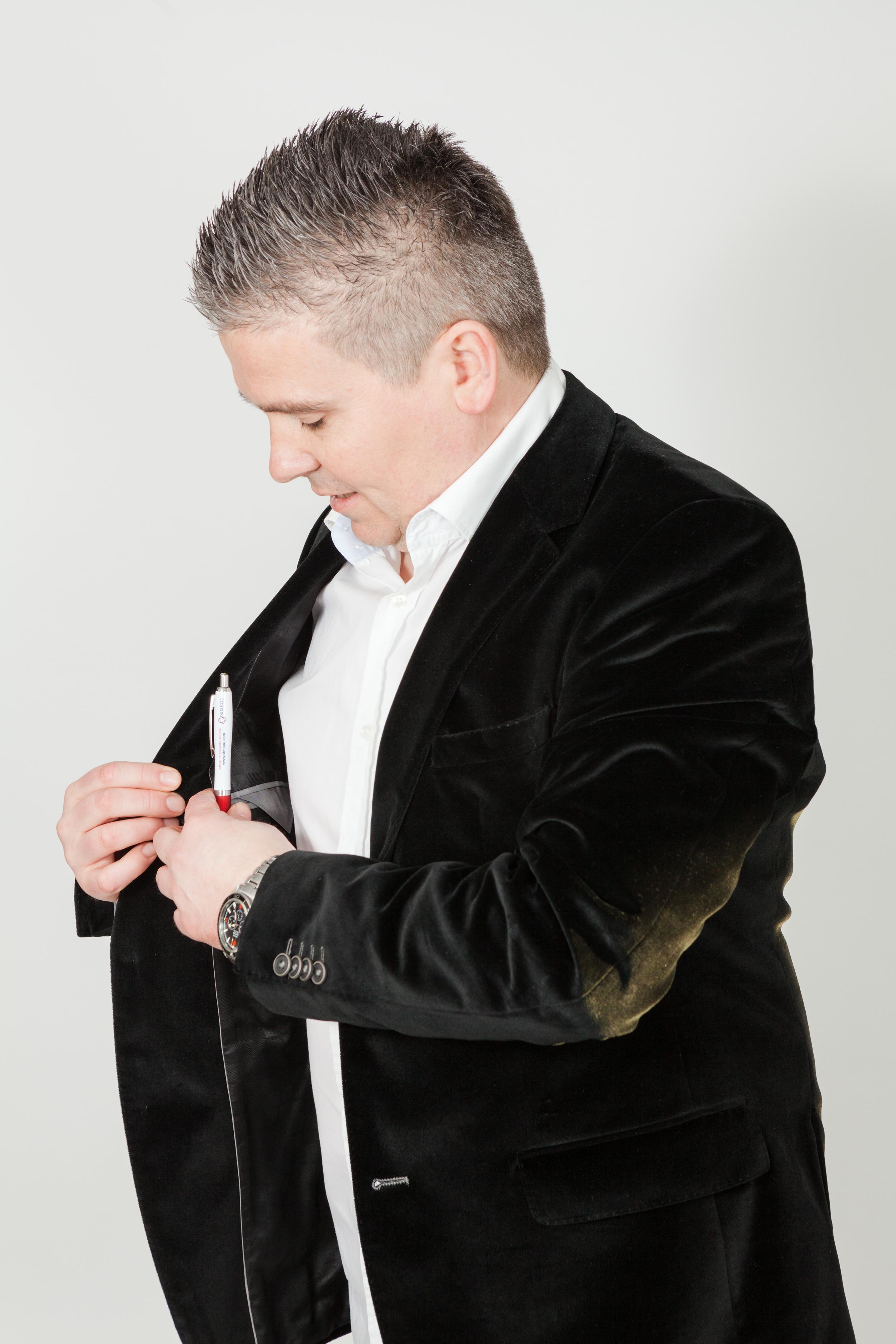 Dave - Black Velvert Jacket putting pen away _SimbocLtd_6789.jpg