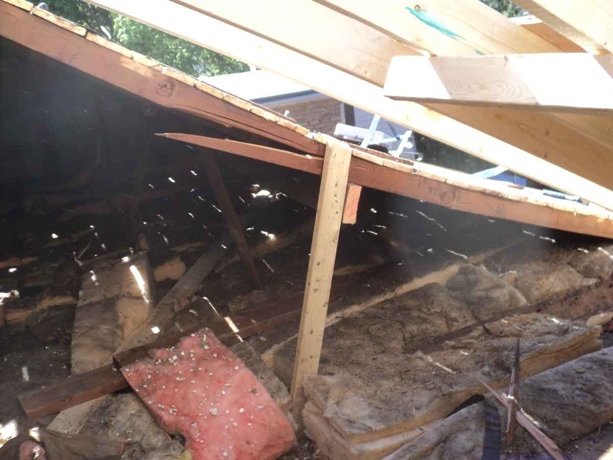 Temporary brace for old roof.