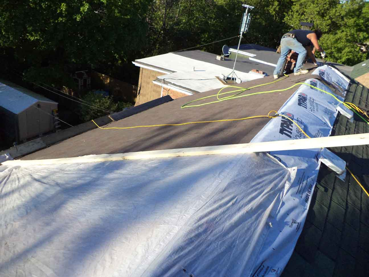 New roof installed and a temporary overnight tarp on the portion that is not yet done. (Job took 10 guys &4 days to do).