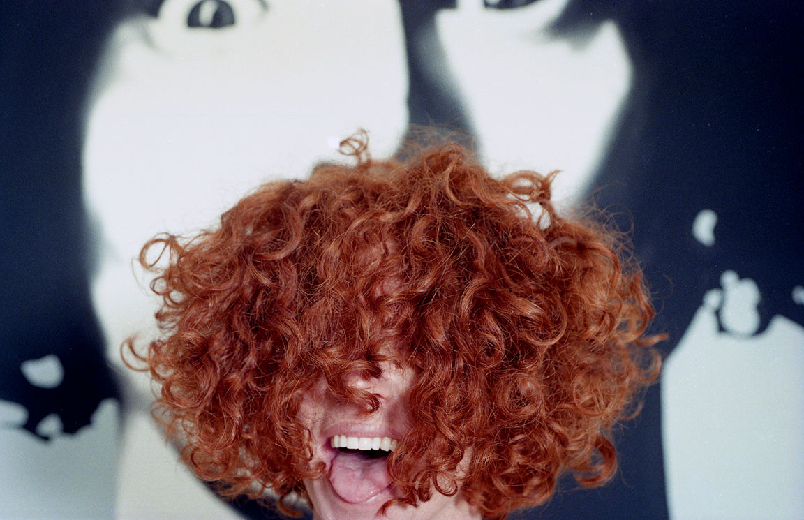 Carrot Top shows off his signature curly hair at his home in Florida.