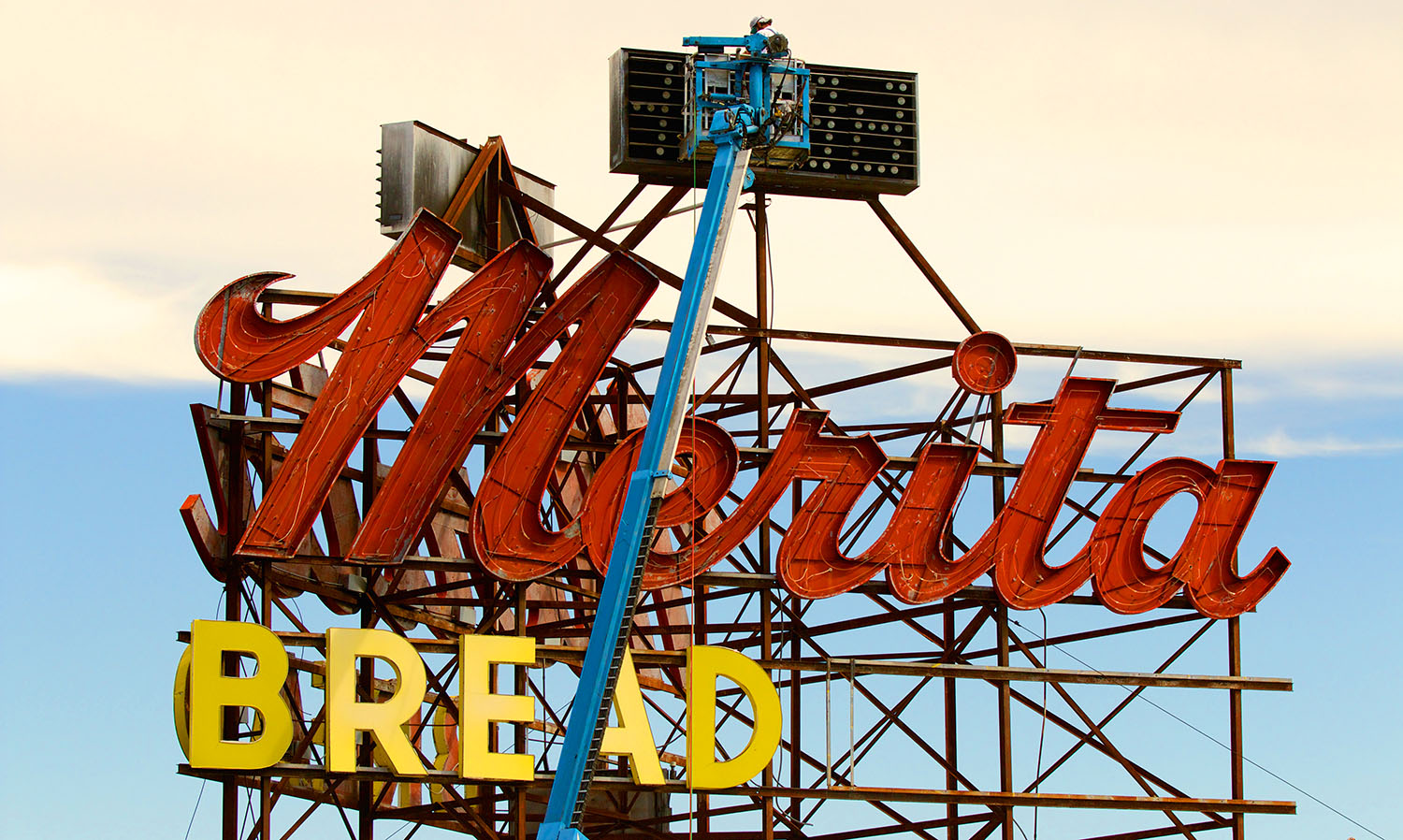 The Morse Museum of American Art removes the sign for Merita Bread to preserve in the museums collection of neon signs.