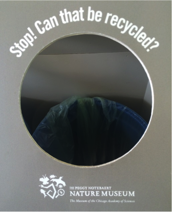A sign on the wall behind the garbage cans at the Peggy Notebaert Nature Museum in Chicago