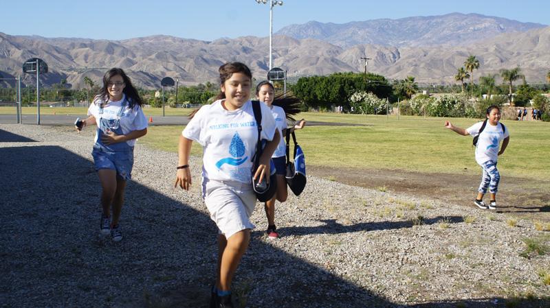girls-running-walk-for-water.jpg