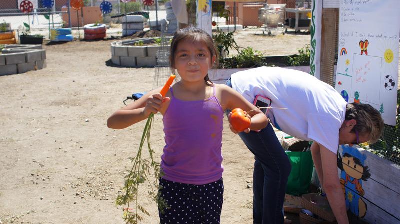 girl-with-tomato-&-carrot.jpg