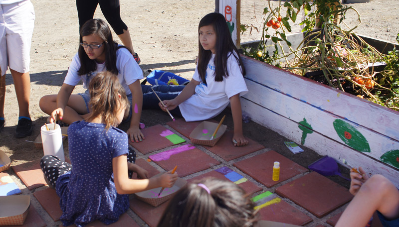 kids-drawing-next-to-garden.jpg
