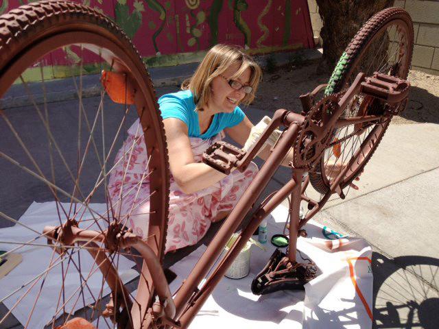 woman-painting-bike.jpg
